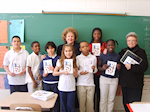 Jane Stark and Maggie Casey with Woodbine Elementary School students representing a multi-generational cookbook which was published by the Museum as a cultural celebration of local food