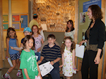 Oranit conducts a summer history treasure hunt with junior visitors from Congregation Beth Shalom of Wilmington, Delaware