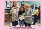 With host teacher Sharon Fruchtman. Ruth receives Lillys of the Valley from student
